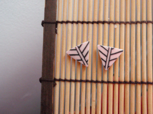 Earrings on a reed mat